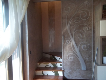 chiusura vano scale con porta in cristallo scorrevole