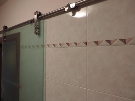 meccanismo della porta in vetro scorrevole